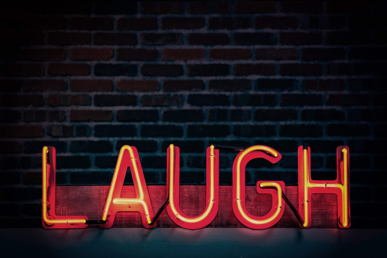 laugh neon light signage turned on 1115680
